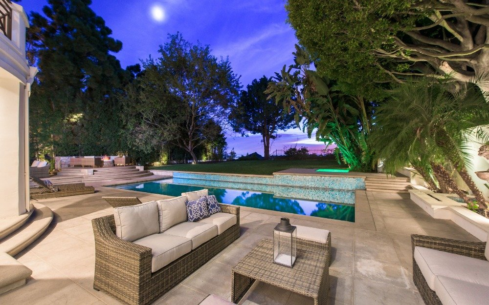 A look at the sitting area next to the home's outdoor swimming pool. Images courtesy of Toptenrealestatedeals.com.