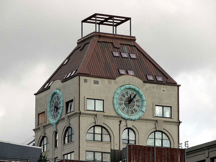This is the exterior view of the bachelor pad. It is an actual clock tower with four functioning clocks on its beige exterior walls. Images courtesy of Toptenrealestatedeals.com.