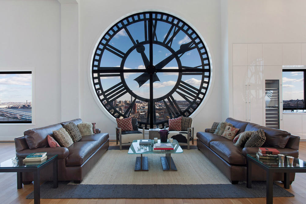 This view of the living room showcases the gorgeous clock window that gives a unique aesthetic value to the living room. Images courtesy of Toptenrealestatedeals.com.