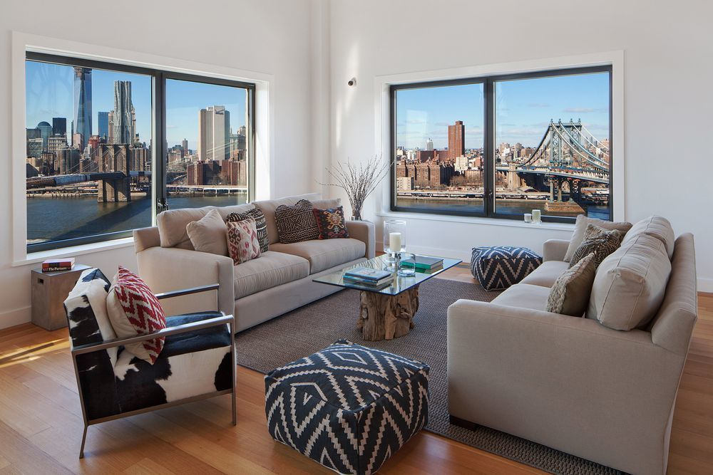 This other living room is placed at the corner with large windows that bring in natural lighting and amazing city view to the beige sofas on the brown area rug. Images courtesy of Toptenrealestatedeals.com.