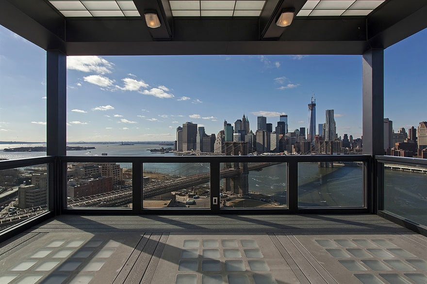 This is the rooftop viewing deck of the unit with a lovely covered area bordered by glass railings for safety and to maximize the amazing city skyline view. Images courtesy of Toptenrealestatedeals.com.