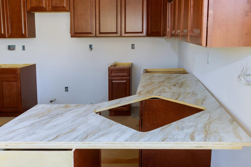 Formica countertop installation in ranch-style house