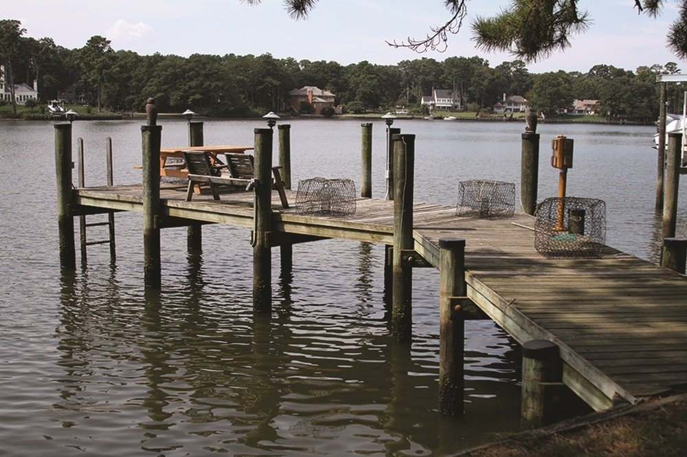 This is the dock of the house with an elevated wooden walkway that is supported by wooden posts. This has a great scenic view of the water and the other estates on the other side. Images courtesy of Toptenrealestatedeals.com.