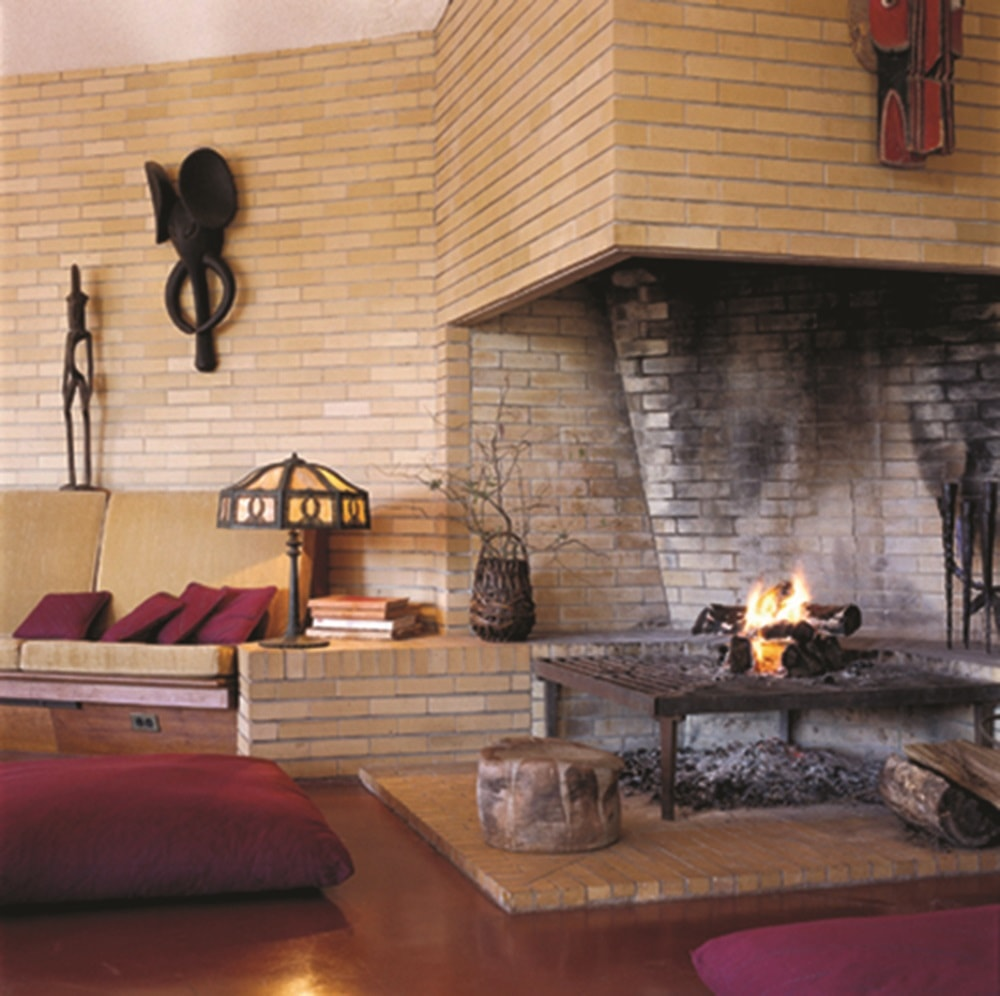 This is a closer look at the large fireplace that stands in the middle of the living room and the kitchen. It fits well into the beige bricks of the wall. Images courtesy of Toptenrealestatedeals.com.