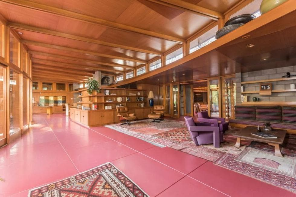 This is a large great room that houses the living room area under its large wooden ceiling with exposed beams and on its lovely terracotta flooring tiles. Images courtesy of Toptenrealestatedeals.com.
