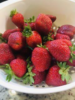 A bowl of fresh ripe strawberries.