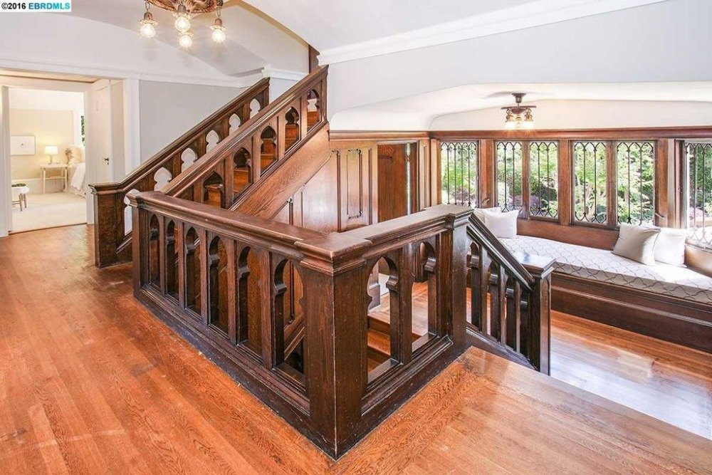 A look at the home's staircase featuring hardwood steps and wooden railings. Images courtesy of Toptenrealestatedeals.com.