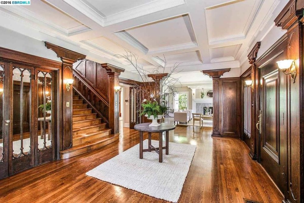 The entry foyer features well-polished hardwood flooring and a white coffered ceiling. Images courtesy of Toptenrealestatedeals.com.