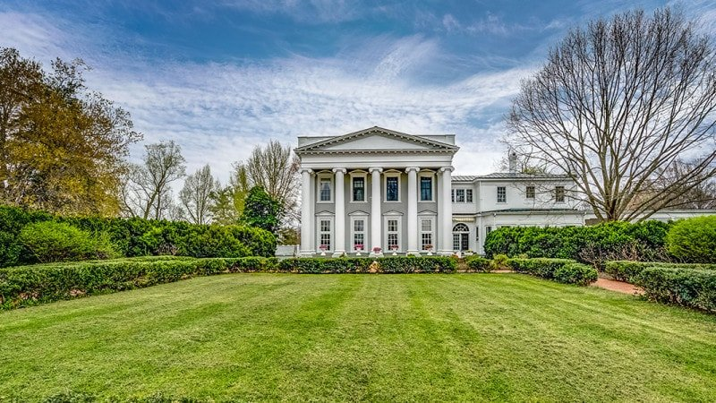 This is the large lawn of grass just beyond the main entry of the house surrounded by low hedges of shrubs. Images courtesy of Toptenrealestatedeals.com.