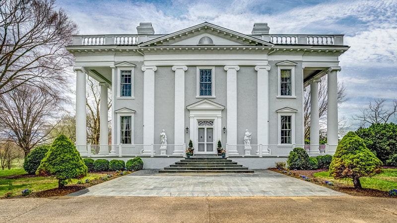 The front of the house has a wide walkway that leads to the front porch and main entrance supported by large white pillars. Images courtesy of Toptenrealestatedeals.com.