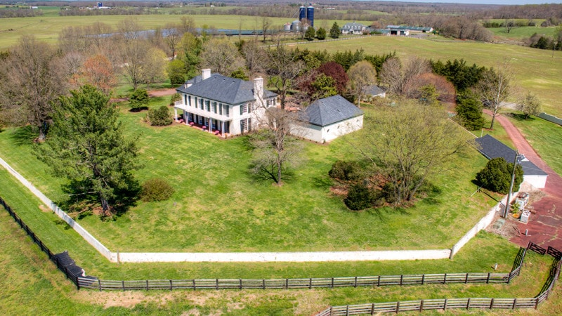 This aerial view of the main house shows that it stands out with its bright exteriors against the lush green landscape that surrounds it. Images courtesy of Toptenrealestatedeals.com.
