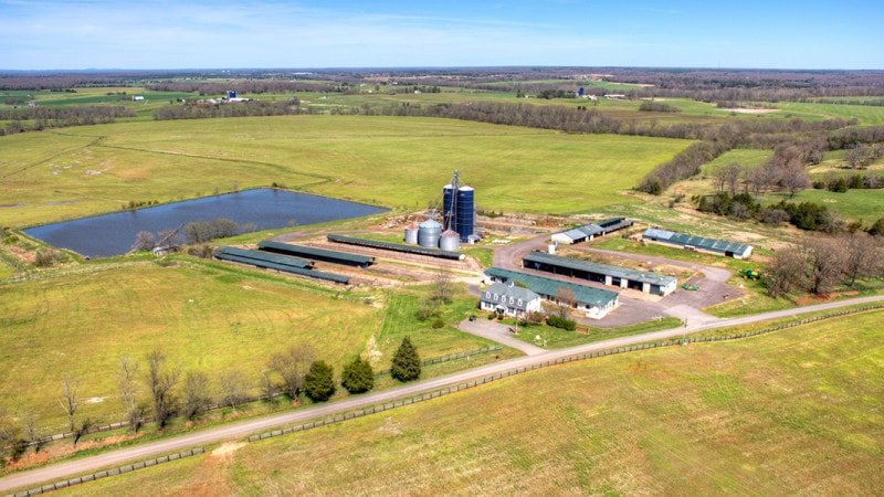This far aerial view of the property shows the various structures of the land along with the surrounding vast farmland. Images courtesy of Toptenrealestatedeals.com.