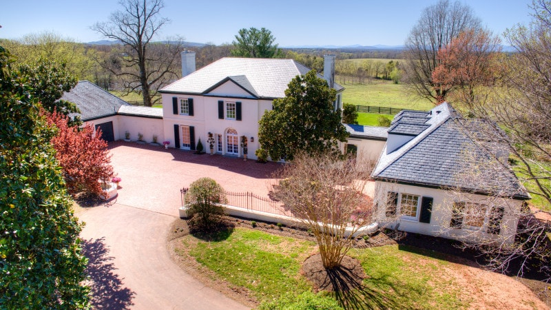 This aerial view of the front of the house shows the wide driveway that leads to the large courtyard in front of the house. Images courtesy of Toptenrealestatedeals.com.