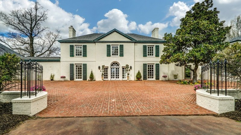 This is the front view of the house with a gorgeous large courtyard made of red bricks to complement the light beige tone of the house exterior. Images courtesy of Toptenrealestatedeals.com.