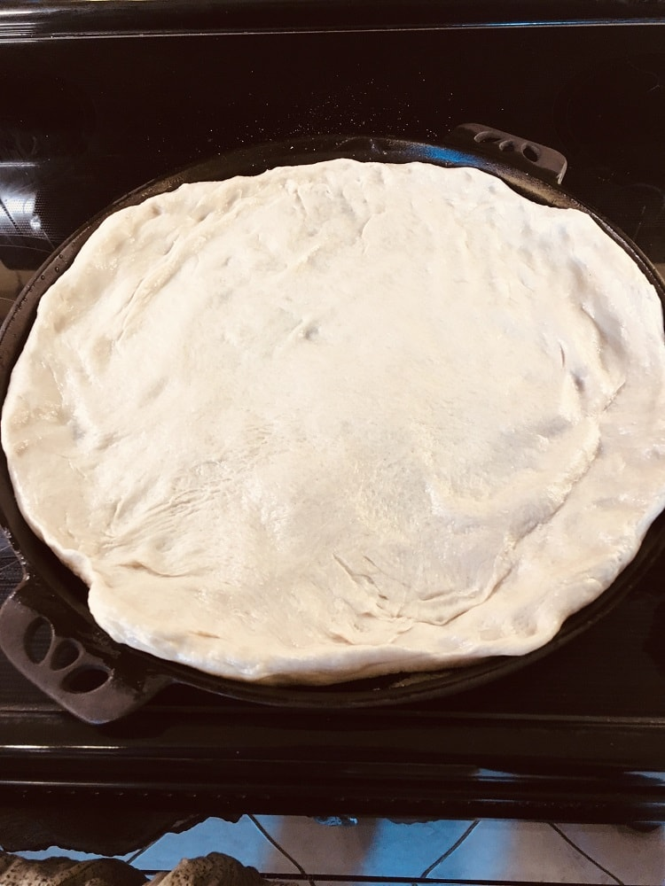 The dough is stretched on a pan.