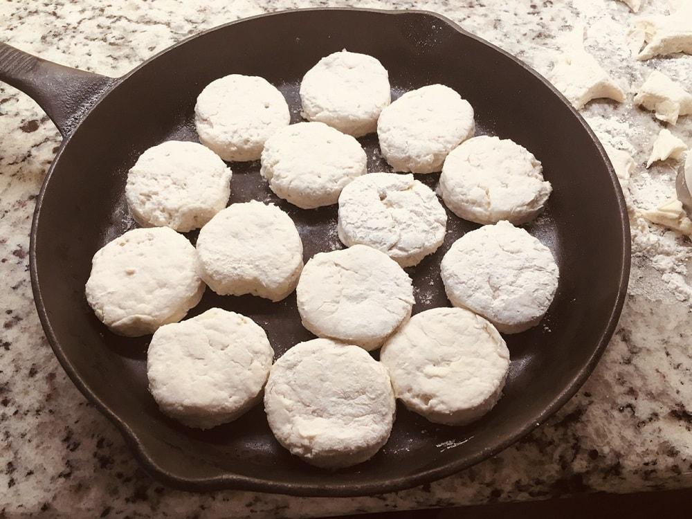 The dough is then shaped into small medallions and placed into a skillet.