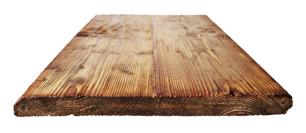 A large piece of wood plank used for tabletop.