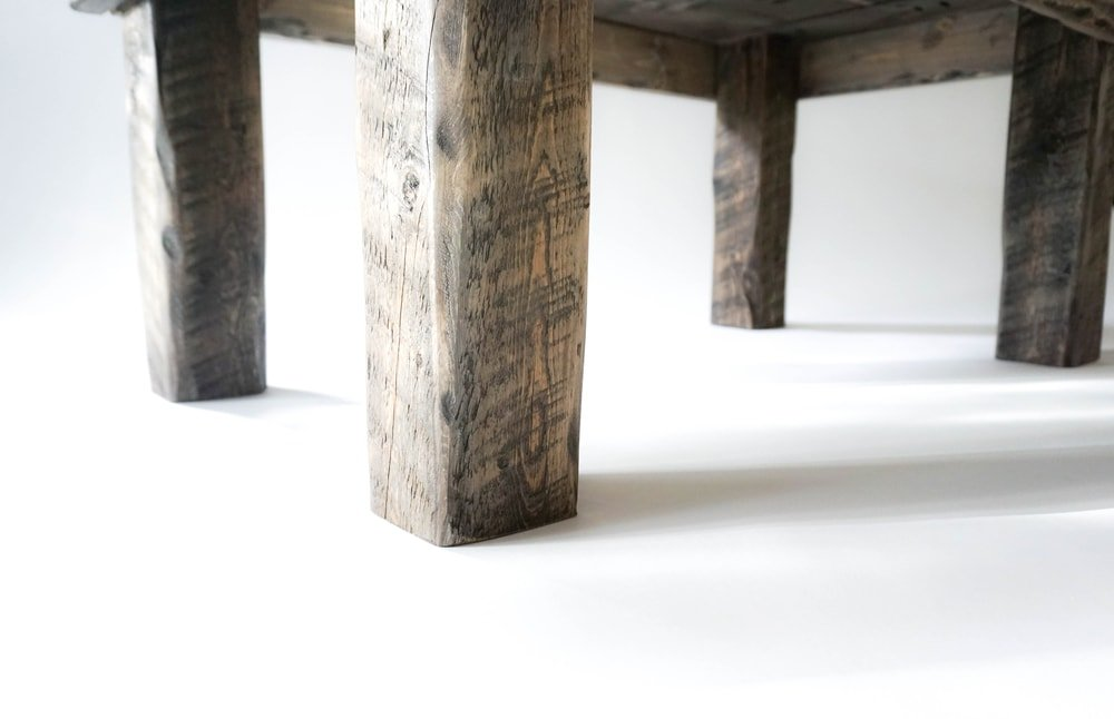 A close look at the wooden legs of a rustic furniture.
