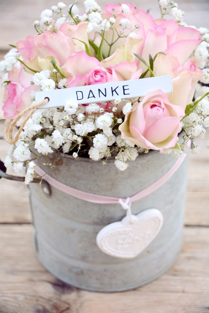 A lovely bouquet of baby's breath placed in a bucket.