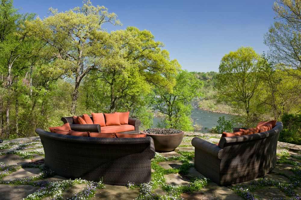 There is a corner of the property fitted with a firepit surrounded by dark brown woven wicker sofas and has a beautiful overlooking view of a serene landscape. Images courtesy of Toptenrealestatedeals.com.