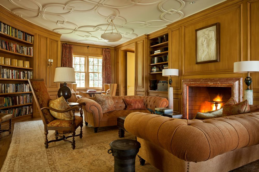 This is the charming and sophisticated library that has its own intimate living room with brown sofas beside the large warm fireplace. Images courtesy of Toptenrealestatedeals.com.