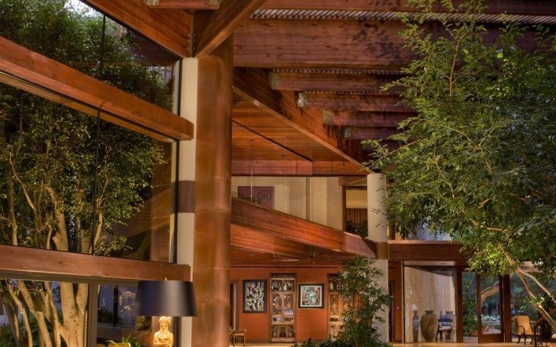 A focused look at the home's towering ceiling with large exposed beams. Images courtesy of Toptenrealestatedeals.com.