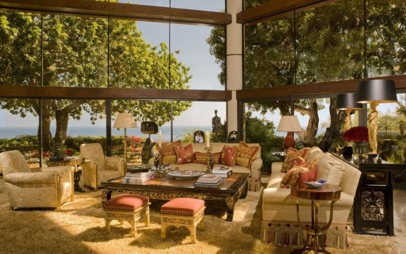 This living space boasts an elegant sofa set surrounded by large glass windows. Images courtesy of Toptenrealestatedeals.com.