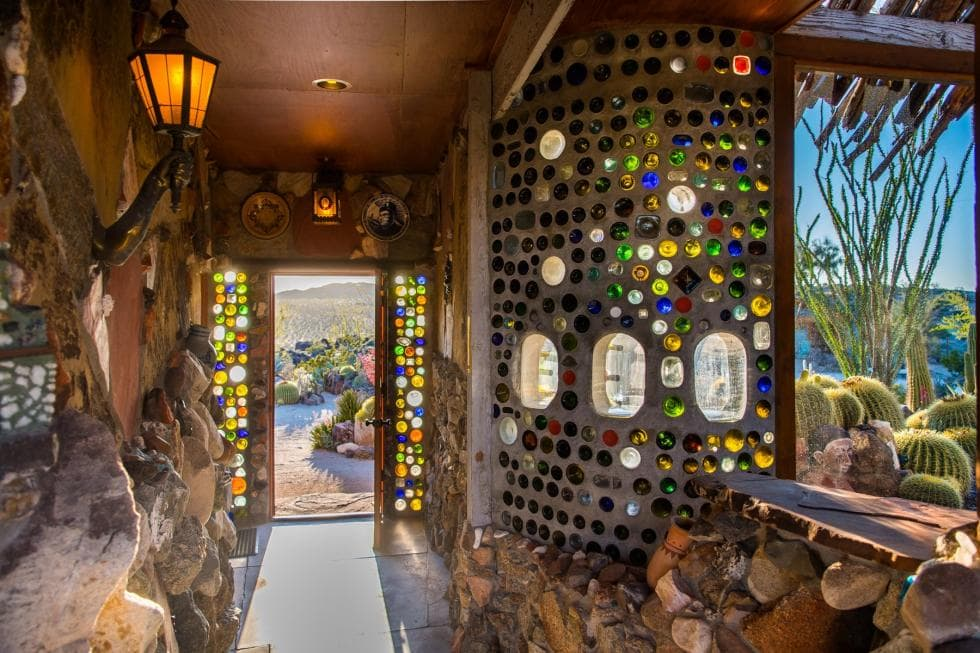 This hallway gives us a closer look at the colorful and artistic mosaic walls of the house adorned with multiple weathered glass. Images courtesy of Toptenrealestatedeals.com.