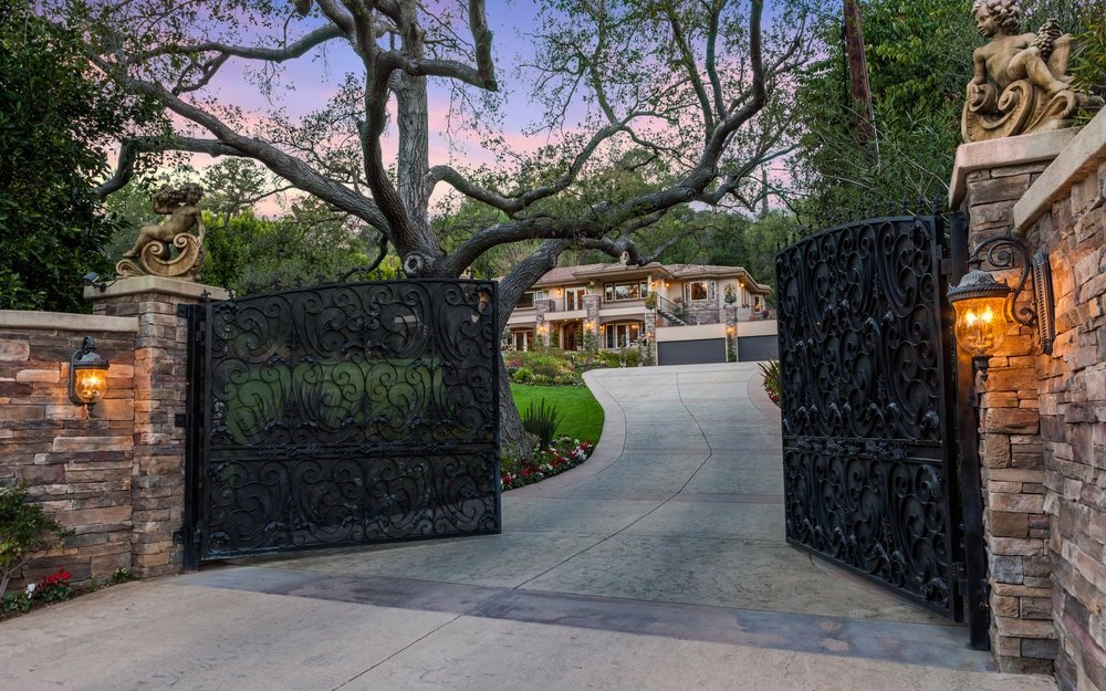 The property has a large wrought-iron gate that provides security as well as add to the aesthetic. Images courtesy of Toptenrealestatedeals.com.