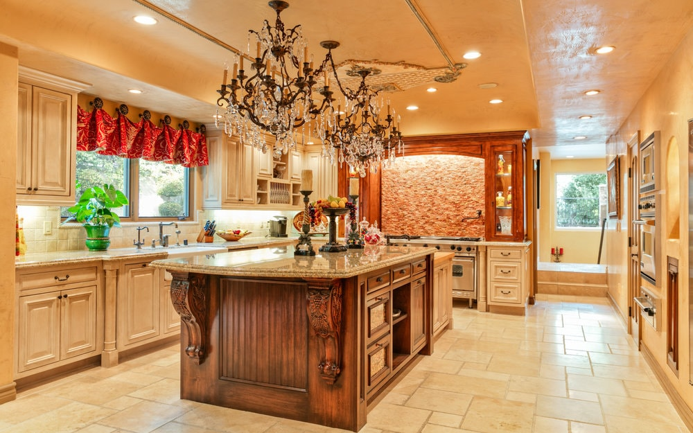 The kitchen has a gorgeous wooden kitchen island that stands out against the beige tone of the floor topped with a couple of charming chandeliers from the beige ceiling. Images courtesy of Toptenrealestatedeals.com.