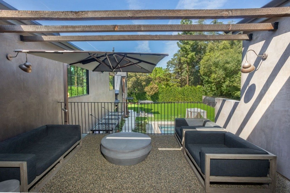 Here's a balcony patio offering a cozy outdoor living space set. Images courtesy of Toptenrealestatedeals.com.