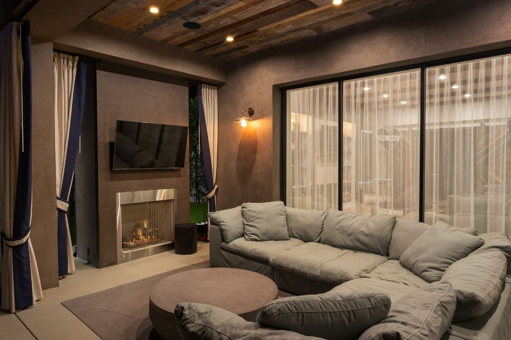 Family living room featuring a cozy sofa set, a fireplace and a flat-screen TV on the wall. Images courtesy of Toptenrealestatedeals.com.