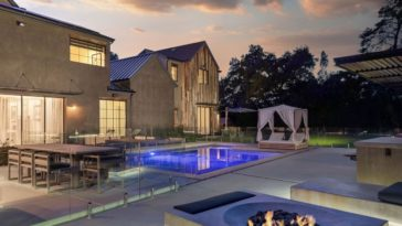 Another look at the home's back area boasting the swimming pool, the outdoor dining and living and the fire pit. Images courtesy of Toptenrealestatedeals.com.