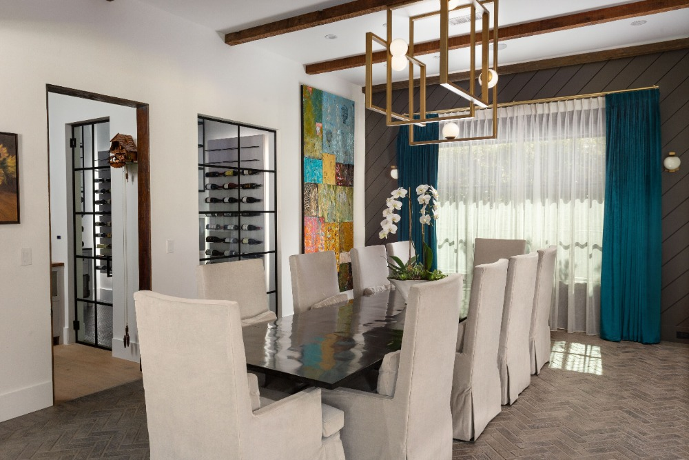 Dining area featuring a rectangular dining table paired with classy white chairs lighted by stylish ceiling lighting. Images courtesy of Toptenrealestatedeals.com.