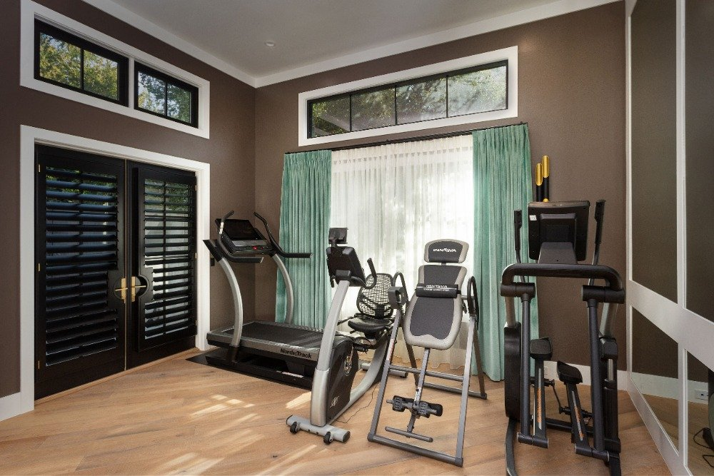 There's a home gym as well, featuring some nice equipment and a wall with large mirrors. Images courtesy of Toptenrealestatedeals.com.