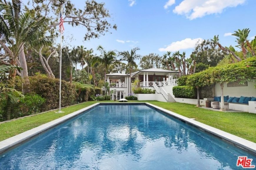 A look at the home's outdoor swimming pool surrounded by the well-maintained lawn area. Images courtesy of Toptenrealestatedeals.com.