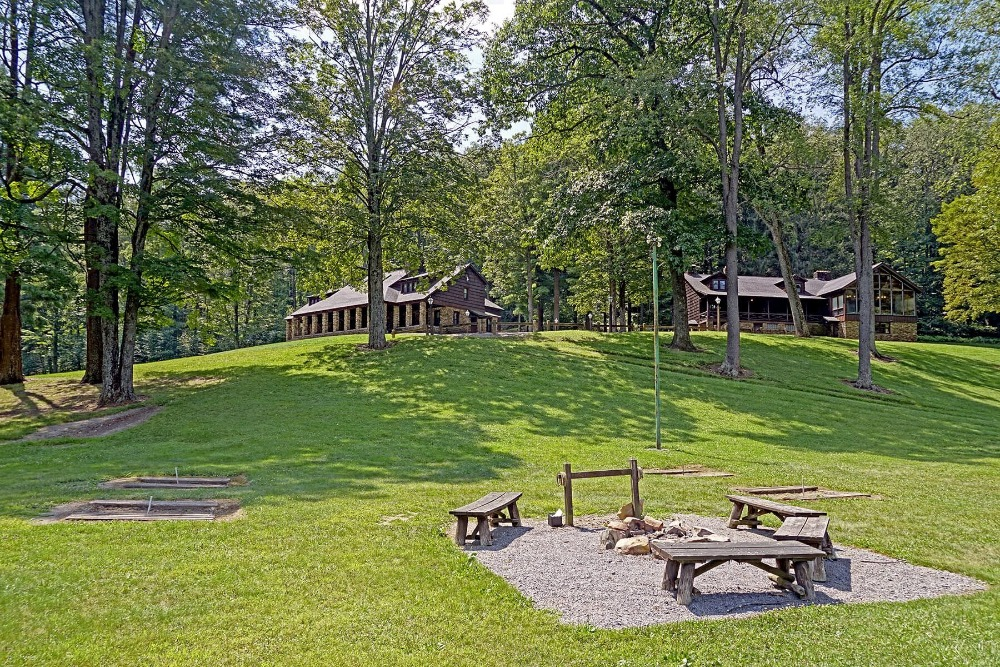 There's a fire pit outside, set on the property's lawn area near the lodge. Images courtesy of Toptenrealestatedeals.com.