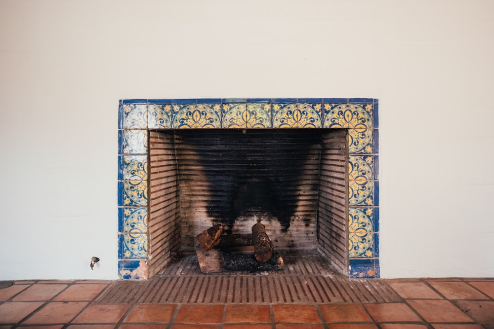 This is a close-up look at one of the fireplaces of the house. It is beautifully bordered with colorful patterned tiles that stand out against the light beige wall and terracotta flooring tiles. Images courtesy of Toptenrealestatedeals.com.