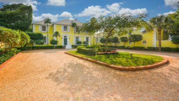 This is the lovely front og the house that has a bright yellow tone on its exteriors. This is complemented by the lush landscaping and the brick driveway. Images courtesy of Toptenrealestatedeals.com.