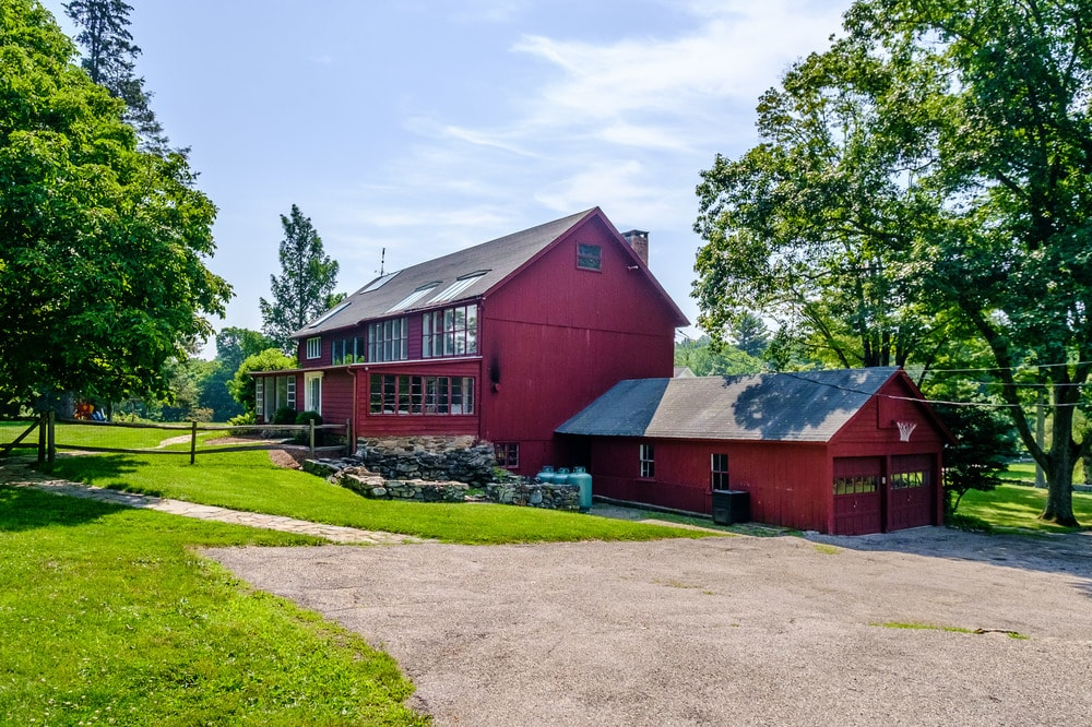 This is the other large structure of the property that used to be barn and is now repurposed. Images courtesy of Toptenrealestatedeals.com.