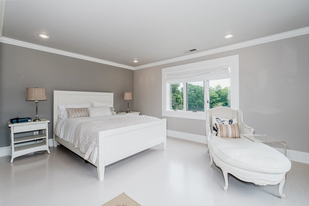 This is simple bedroom with a white sleigh bed to match the daybed at the foot as well as the bright white floor. Images courtesy of Toptenrealestatedeals.com.