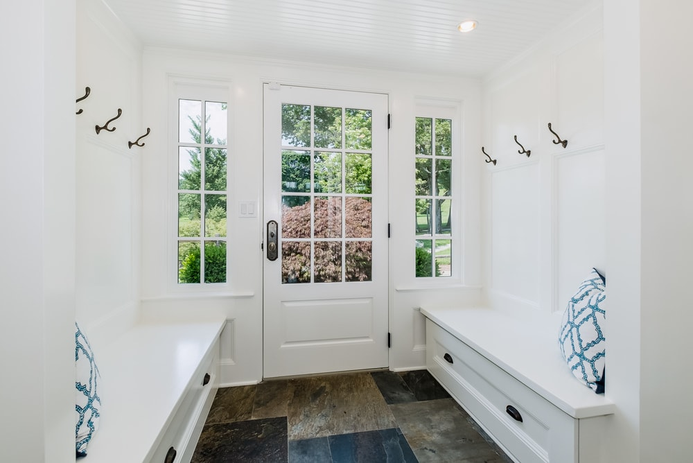 This is the simple yet charming foyer with glass panels on its main door to let in natural light and illuminate the white walls, ceiling and built-in benches on both sides topped with wall-mounted hooks for coats and hats. Images courtesy of Toptenrealestatedeals.com.