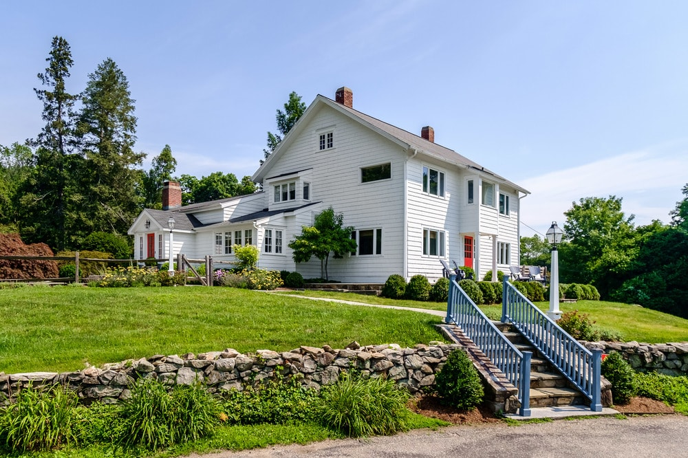 This view of the house makes you appreciate more of its bright exterior walls and tall chimneys. These are then complemented by the wonder landscaping that surrounds it. Images courtesy of Toptenrealestatedeals.com.