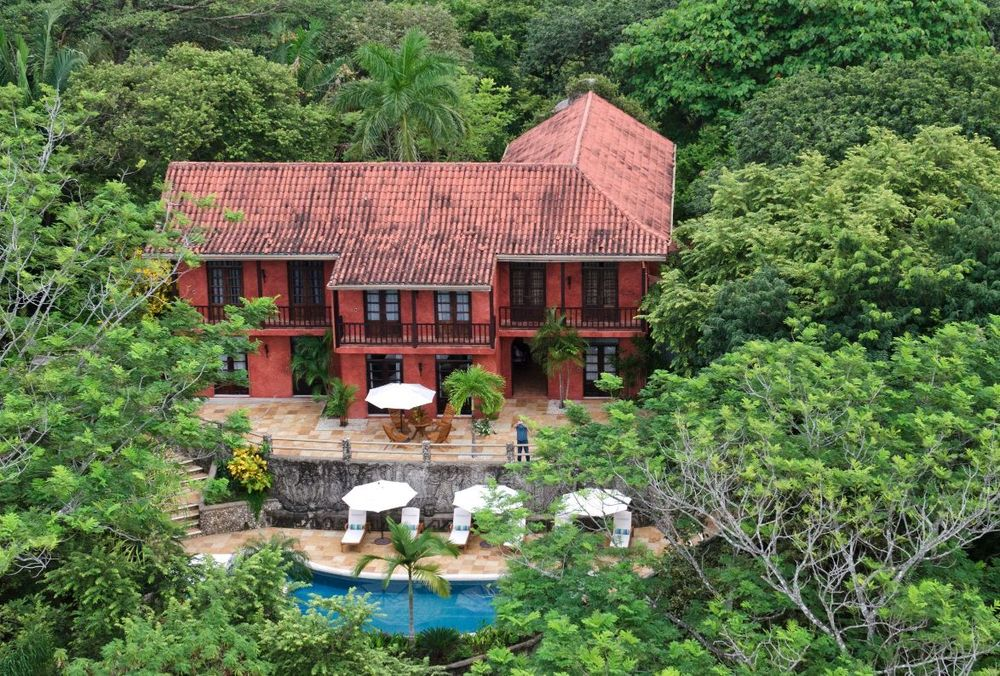 This aerial view of the house shows the lovely pool at the back of the house. It is almost fully covered by the tall tropical trees giving it the ultimate privacy. Images courtesy of Toptenrealestatedeals.com.