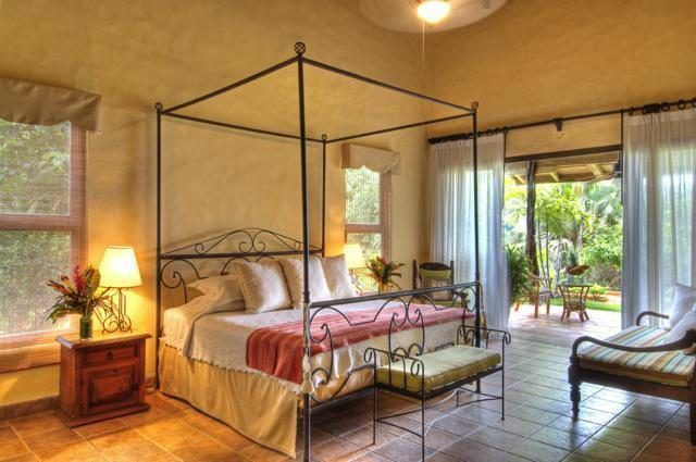 This charming bedroom has a large four-poster bed that stands out against the beige walls and tall ceiling. Images courtesy of Toptenrealestatedeals.com.