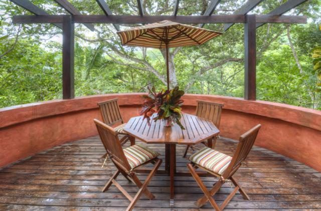 Just a few steps from the dining area is this beautiful outdoor area that is perfect for breakfasts. It has open walls that give the outdoor area a lush view filled with tall trees. Images courtesy of Toptenrealestatedeals.com.