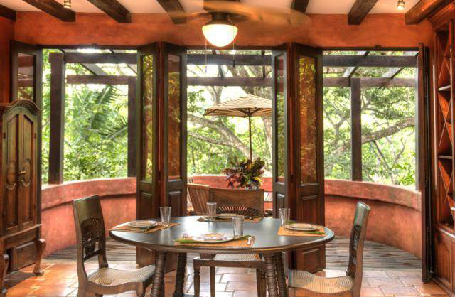 This is the dining area of the house. It has a round wooden dining table that matches with the exposed beams of the ceiling warmed with a semi-flush mount lighting. Images courtesy of Toptenrealestatedeals.com.
