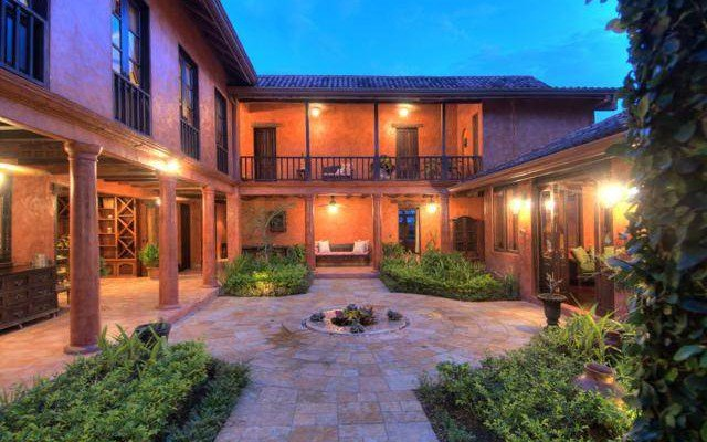 This is the main courtyard at the front of the house with miniature gardens of lush shrubs on the sides to complement the warm glow of the house exteriors. Images courtesy of Toptenrealestatedeals.com.