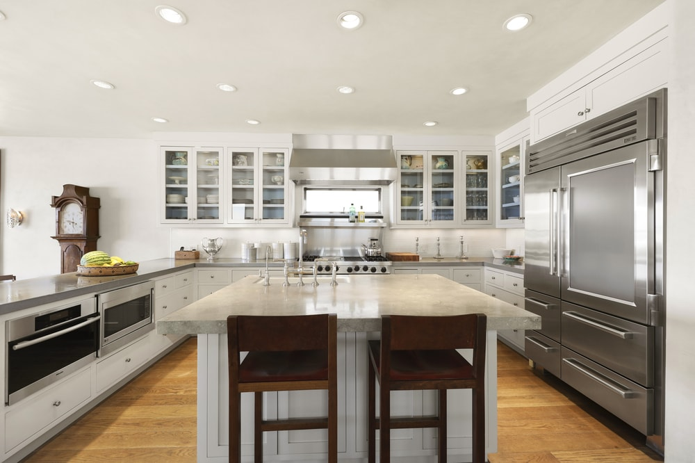 The kicthen has a large kitchen island in the middle of the hardwood flooring that complements the light tone of the cabinetry that matches well with the surrounding walls and ceiling. Images courtesy of Toptenrealestatedeals.com.
