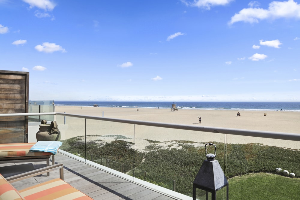 This is the gorgeous view of the beach from the vantage of the second floor balcony. You can see here that there is a glass railing for safety and to maximize the view of the beach. Images courtesy of Toptenrealestatedeals.com.